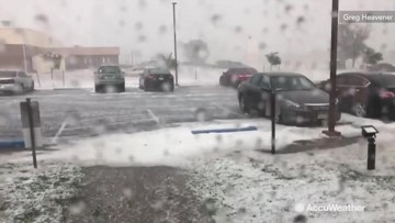 Hail storm makes Colorado parking lot look snow covered