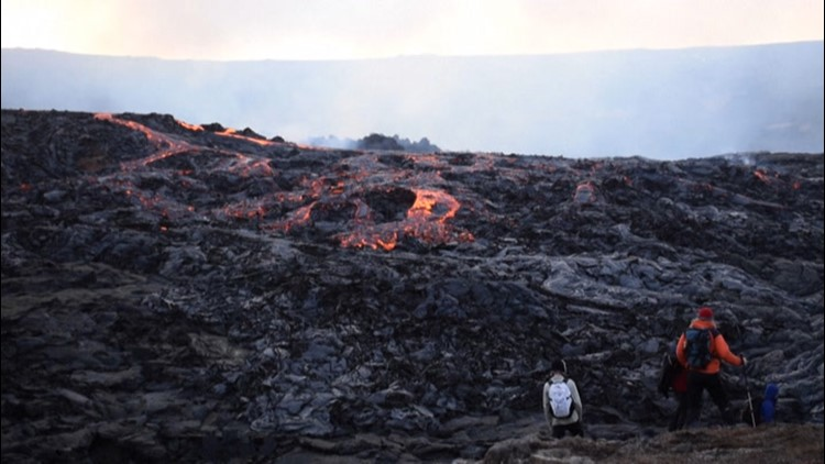 Guests watch as lava pours from volcano