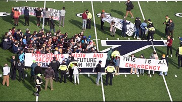 Protesting students storm field, delay Harvard-Yale football game; More than 20 arrested