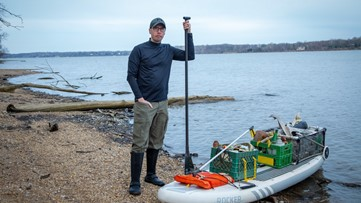 One man's mission to clean up the Potomac River on paddleboard