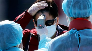 Japan says 23 cruise passengers not tested for virus before disembarking