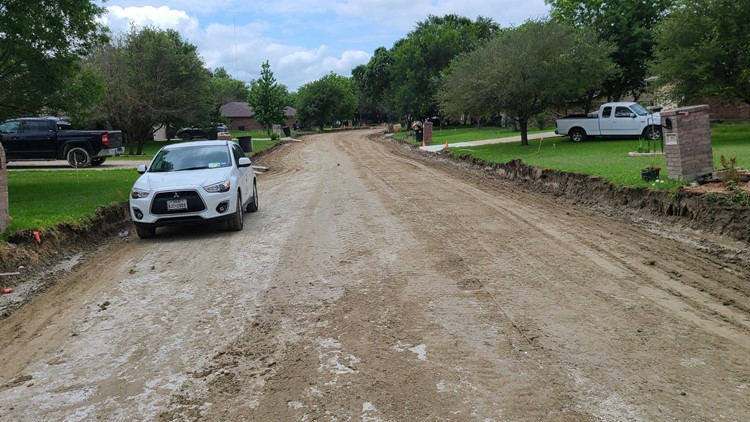 Months later, Melrose Lane in South Temple still a muddy mess