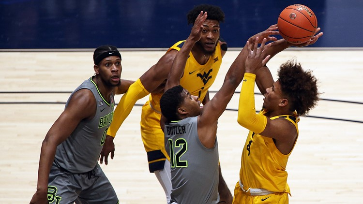 Baylor edges over West Virginia in OT to score conference title