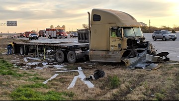 Driver hospitalized after jackknifed semi-truck on I-35