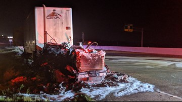 Driver injured after semi-trailer catches fire on I-35