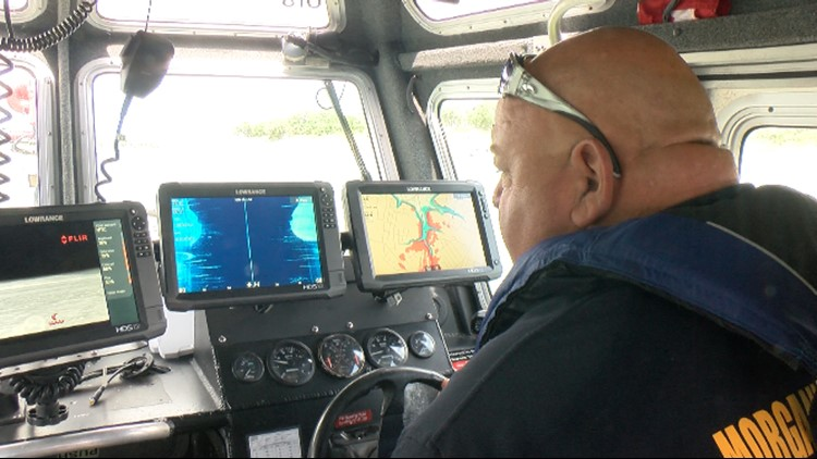 Victor Hall, Morgan's Point Resort Fire Department captain of marine operations, steers Marine 61 while monitoring imaging systems.