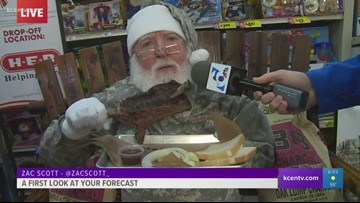 Camo Santa eats BBQ during Zac's forecast