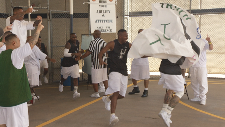 Inmates run onto the court at Alfred D. Hughes Unit