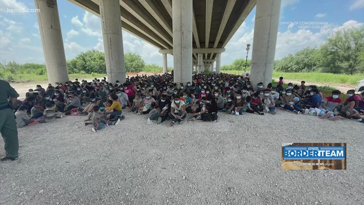 'There's too many people coming in' | Border Patrol processing migrants in unsheltered area under bridge as influx continues