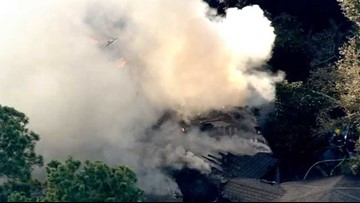Two people burned, pets feared dead in multi-million dollar mansion fire in The Woodlands