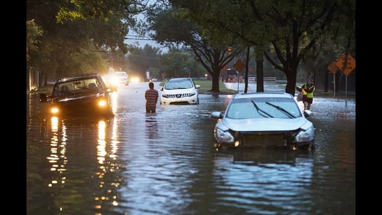 Stranded vehicles sit where they got stuck in high water from Hurricane Harvey on Dairy Ashford Drive, August 28, 2017 in Houston, Texas.