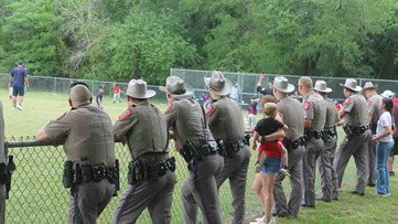 DPS troopers line up to cheer on son of injured trooper at baseball game in Bryan