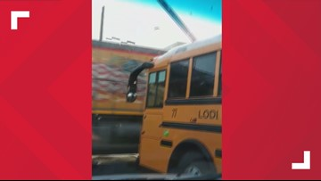 WATCH: School bus stops just inches from fast-moving freight train, Lodi school district investigating