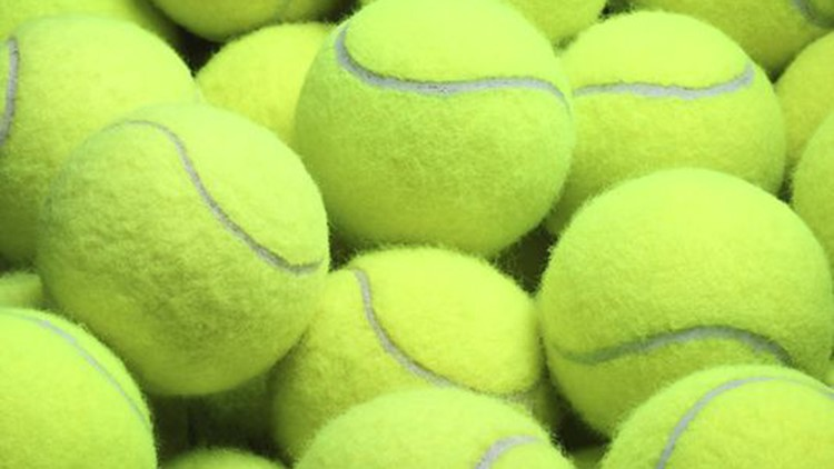 The Clinton Fire Department said the tennis balls had been filled with hundreds of match heads and a striking device and turned into essentially homemade bombs.