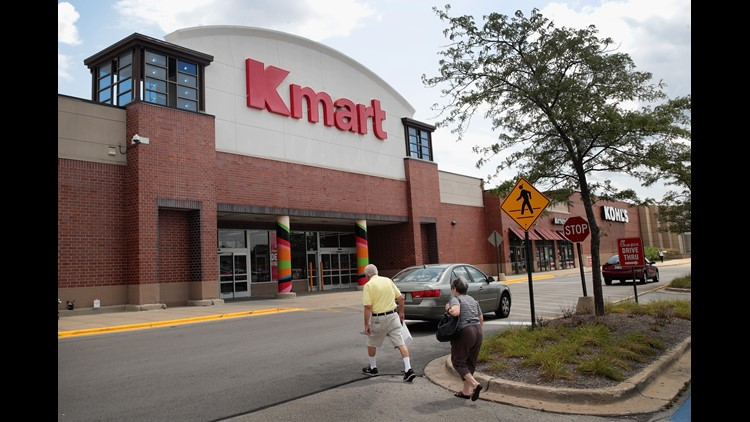 Shoppers walk toward a Kmart store on August 24, 2017 in Elmhurst, Illinois. Sears Holdings Corporation, the owner of Kmart, said today it was planning on closing another 28 Kmart store including this Elmhurst location.