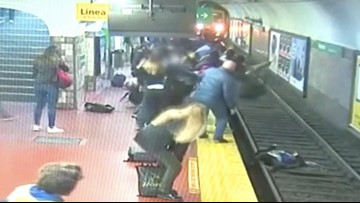 Woman's Dramatic Rescue from Subway Tracks Caught on Camera in Buenos Aires
