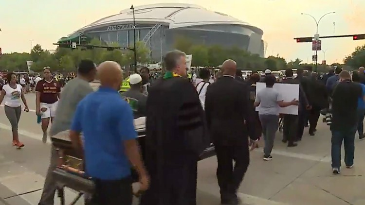 Carrying coffins, demanding justice: protesters rally for Botham Jean before Cowboys game