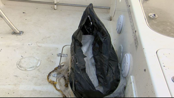 Fishermen haul in a big one, but it's not a fish. It's a bag with nearly $1M worth of cocaine