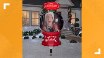 This giant inflatable snow globe can project Christmas movies right in your front yard