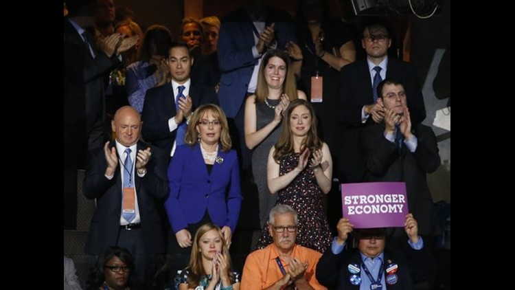 Former U.S. Rep Gabby Giffords (center) stands with her husband and former NASA astronaut Mark Kelly (left) and Chelsea Clinton (Photo: Michael Chow/USA TODAY NETWORK)